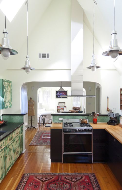 Like the open space: Green Tile, Dreams Kitchens, Lights Fixtures, Open Spaces, Design Sponge, High Ceilings, Vaulted Ceilings, Open Kitchens, Red Rugs