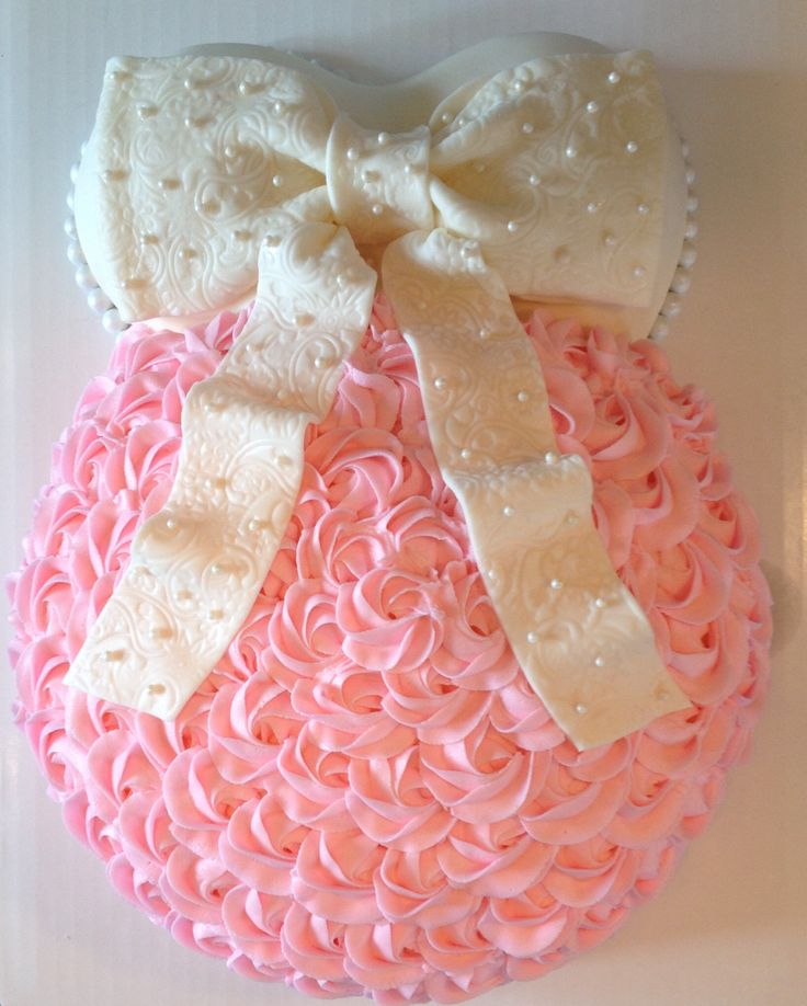 Baby belly; baby bump baby shower cake; pink and white; rosettes