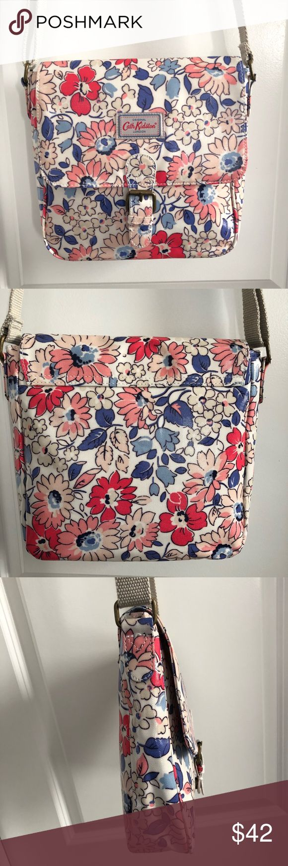 "Cath Kidston Floral Coated Canvas Crossbody Bag Blue, pink and blush florals on a cream background with tan adjustable strap. Fold over snap closure (buckle is decorative). One inside zip pocket. Coated cotton pvc makes it easy to keep clean. Ordered from Cath Kidston store in London. Like new, only used once. Great pops of color for Spring and Summer.  Measures approx 10""x10"". Depth approx 2 1/2"". Cath Kidston Bags Crossbody Bags"
