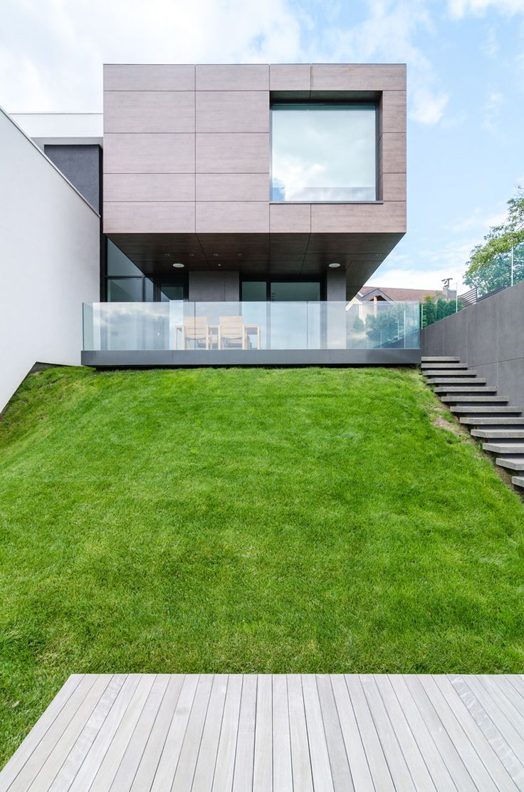 Modern Volumetric Architecture Beautifully Integrated in its Surroundings- P. House by DE3, Targu Mures, Romania