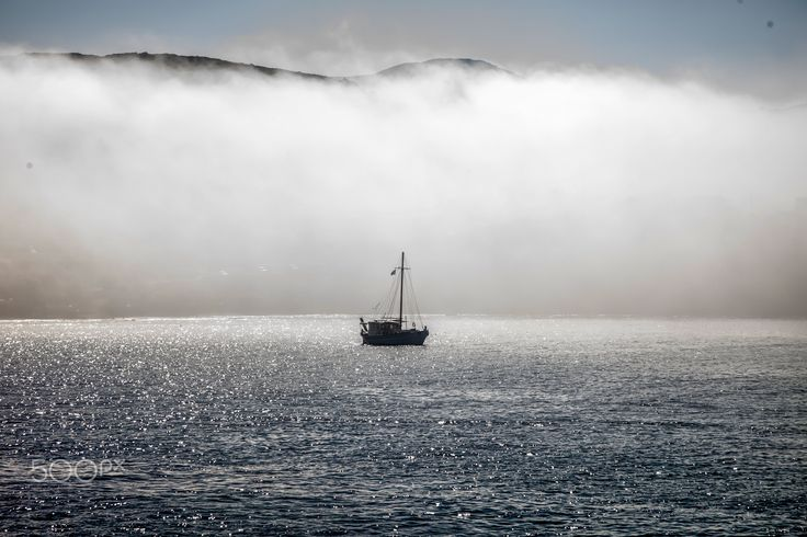 Boat in the Fog - This photo was shot on arrival on the island of Syros in Greece.  I managed to take this photo as the fog was slowly clearing up early in the morning.