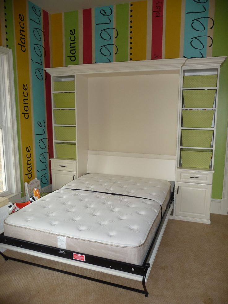 Murphy bed, queen size with doors open.  This playroom becomes a guest room just like that!