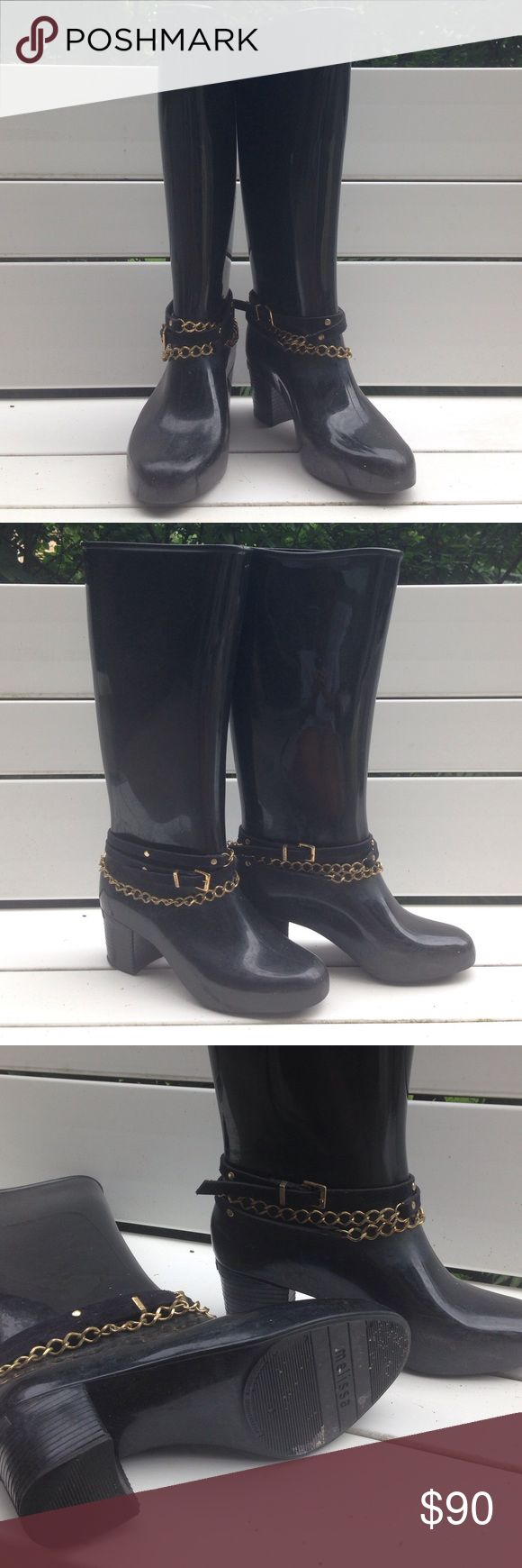 MELISSA black tall rain boots w/ heel + ankle wrap All black tall rain boots hardly worn, 100% rubber and waterproof! They are comfortable and a beautiful classic boot my MELISSA! Bought in Brazil where the brand is from. Amazing condition and won't ruin your style when it's raining outside. Added chain and leather stud ankle wrap which is removable but why would you want to do that? :) melissa Shoes Winter & Rain Boots