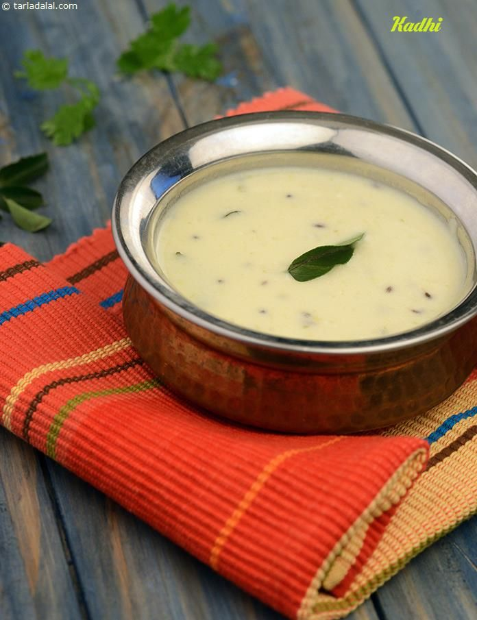 Kadhi is inseparable from gujarati cuisine. It is basically a wonderful sweet and spicy curd mixture thickened with gram flour, which can be enhanced in many ways using other ingredients like pakoras and koftas.