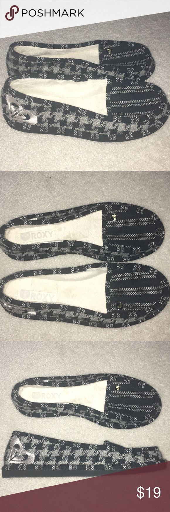 Roxy brand slipper/loafer. Size 8. Never worn. Roxy brand loafer/slipper. Black and grey stripes on top. Houndstooth/checker design on side. Soft fur lining on inside. Roxy symbol on ankle of each shoe. Never worn. Without original box. Roxy Shoes Flats & Loafers