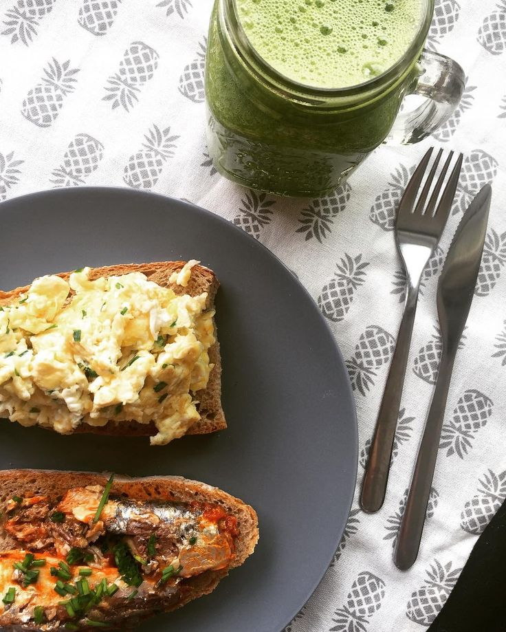 Perfect brunch to fuel some last minute finals revision and my long run this afternoon Wholemeal and rye sour dough toast topped with @steweeggs chive scrambled eggs  and tinned sardines  which are a great cheap source of good fats protein  and vitamin D  with a veggie smoothie