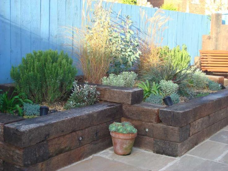 howard traceys mediterranean garden with railway sleepers