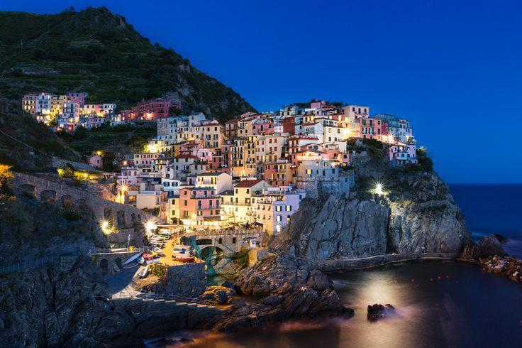 Manarola, Cinque Terre Italy - The small typical village of Manarola at night.