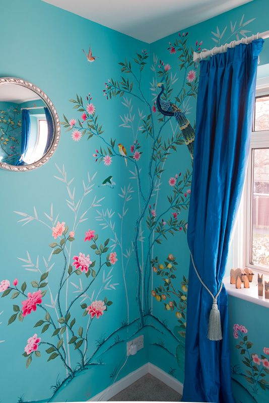 Diane Hill hand painted interiors turquoise chinoiserie mural. Colourful nursery (or children's bedroom) inspired by 18th century silk wallpaper. Create a stunning interior design for your home decor, or a feature wall. This corner of the nursery interior features chinoiserie peonies and a beautiful chinoiserie peacock nestled in a tree.