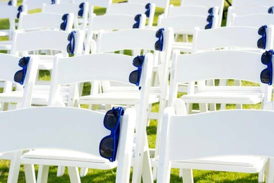 Having an outdoor ceremony? Leave a fun pair of sunglasses on each guest's chair.