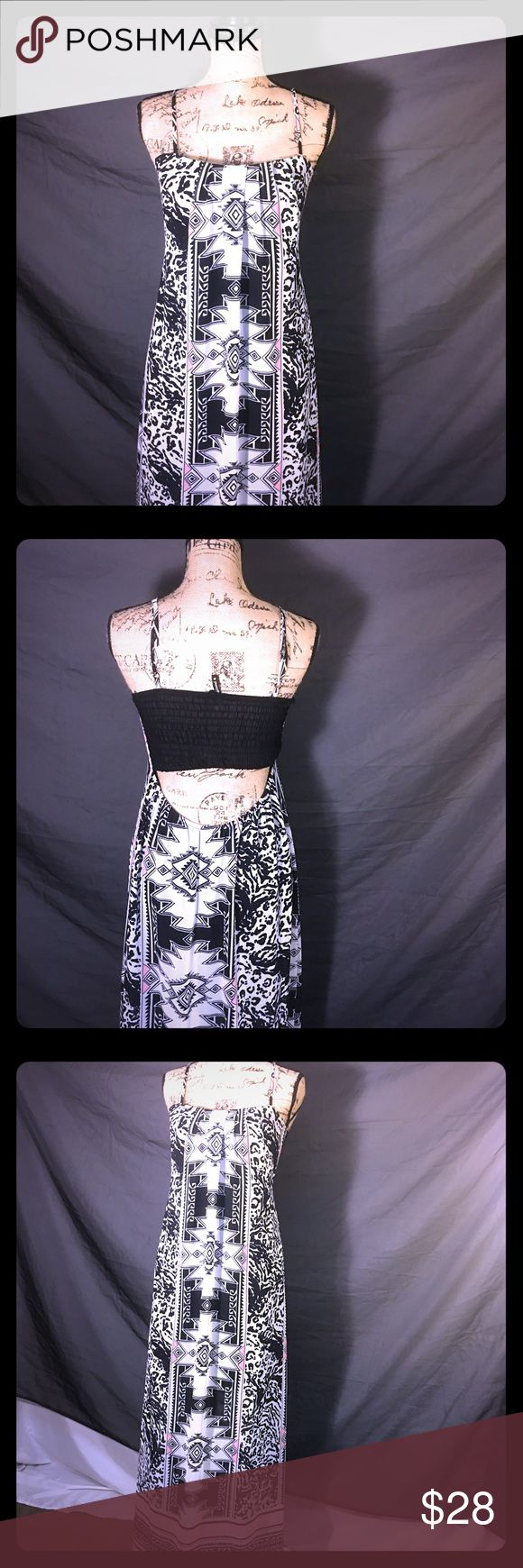 "🌼 🔥SALE TONIGHT ONLY🔥 Cheetah Tribal Maxi Dress •AS GOOD AS NEW• PERFECT CONDITION• OFFERS WELCOME•. Beautiful long sheer backless Maxi dress with a mix of black while and pink, cheetah print and tribal designs. Slip / liner underneath. Worn one time.  **I have my mannequin standing at my height 5""7. ** Dresses Maxi"