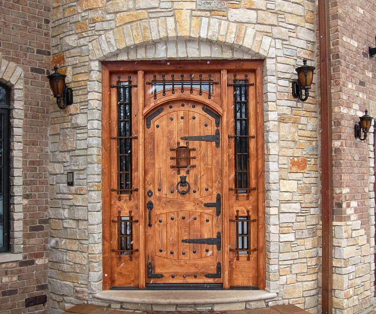 The Metal Work On This Knotty Alder Door Makes An Entry