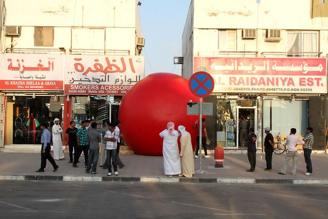 RedBall : Abu Dhabi by Kurt Perschke. The first public intervention piece to take place throughout the Emirate of Abu Dhabi, the RedBall Project took place over 30 days this winter. With installations ranging from The Sheikh Zayed Bridge by Zaha Hadid to the Empty Quarter of the Western Region it was the most wide ranging project to date and the first in the Middle East. Tony Gaddis of Fountain Studio was on location for the entire time and created a unique look into place and culture.