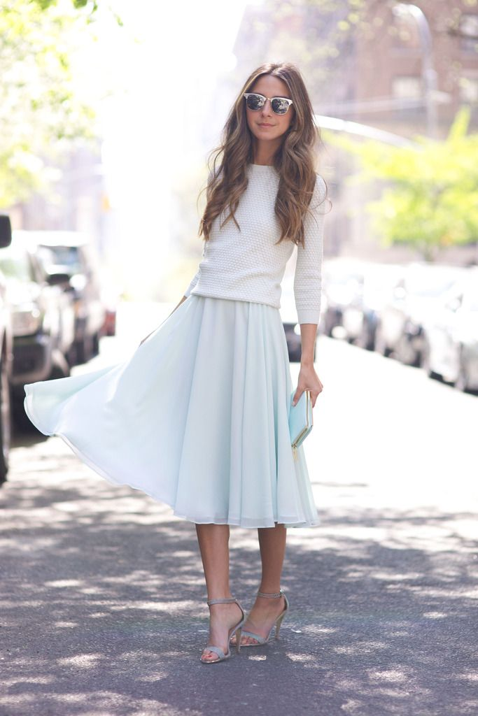 White pullover. Midi skirt. Clutch. Sandals.