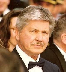 "Charles Bronson -- (11/3/1921-8/30/2003). American Film & Television Actor. Movies -- ""The Magnificent Seven"" as Bernardo O'Reilly, ""The Great Escape"" as Danny 'Tunnel King', ""Death Wish 1, 2, 3 & 4"" as Paul Kersey, ""The Dirty Dozen"" as Joseph Wladislaw, ""Once Upon a Time in the West"" as Harmonica, ""Hard Times"" as Chaney, ""Death Hunt"" as Albert Johnson and ""A Family of Cops I, II & III"" as Paul Fein. He died of Pneumonia and Alzheimer's Disease, age 81. Born: Charles Dennis Buchinsky."