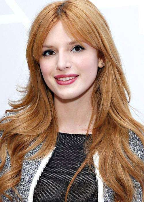 Цвет волос приглушенно рыжий