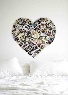 Polaroids in hartvorm boven het bed. Wow wat leuk bedacht zeg om je polaroids zo op te hangen. Geeft een hele mooie romantische sfeer aan de slaapkamer.