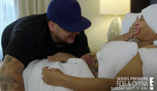 True love? Blac Chyna and Rob Kardashian share a tender moment as he kisses her tattooed bump inhe 30-second trailer for Rob & Blac, E!'s upcoming six-episode show