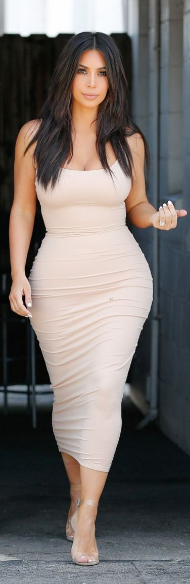 Who made  Kim Kardashian's nude dress and clear sandals?