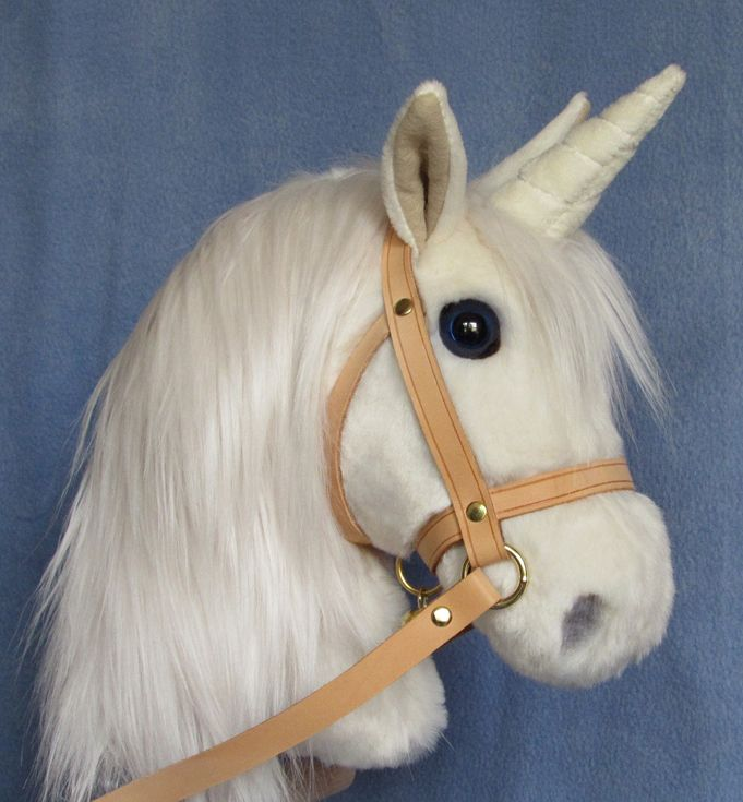 Beautiful hobby unicorn with long flowing mane, blue safety eyes and a natural leather bridle. New design.