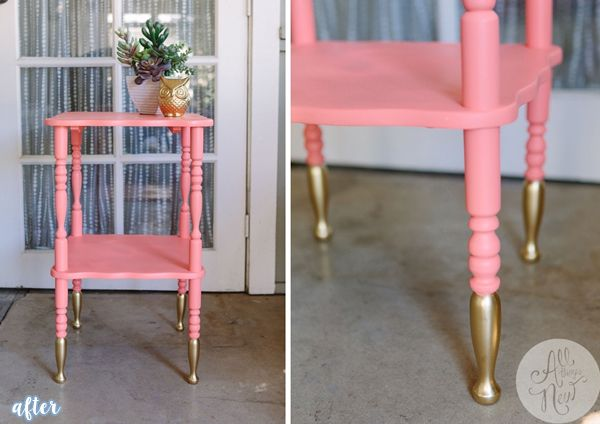 Beat up old brown wood table painted coral and legs dipped in gold.