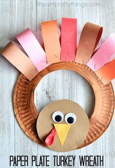 If your kids love helping you decorate for the holidays they are going to love making this adorable paper plate Thanksgiving turkey wreath. Fun Thanksgiving kids craft, turkey craft for kids and thanksgiving diy.