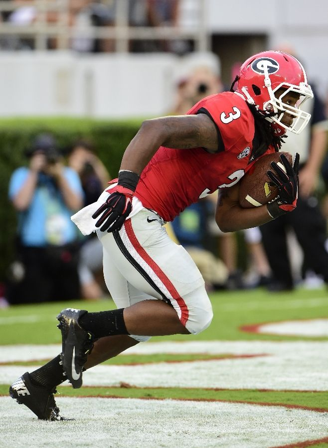 Georgia Football - Bulldogs Photos - ESPN ATHENS, GA - AUGUST 30: Todd Gurley #3 of the Georgia Bulldogs returns a kickoff for a 100 yard touchdown against the Clemson Tigers at Sanford Stadium on August 30, 2014 in Athens, Georgia. (Photo by Scott Cunningham/Getty Images)