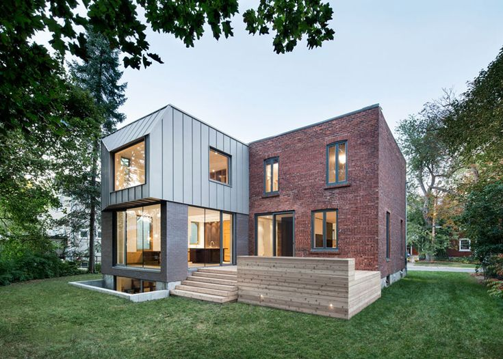Steel cladding frames an offset window at this Montreal house extension.