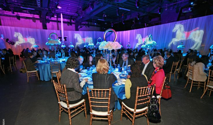 FOS Decor - Carousel Horse projection at BMO Event #eventdecor #eventdesign #lighting #eventlighting