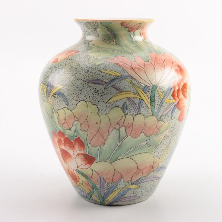 Chinese hand painted porcelain floral motif vase with coral and yellow flowers on soft green background. Made in China.