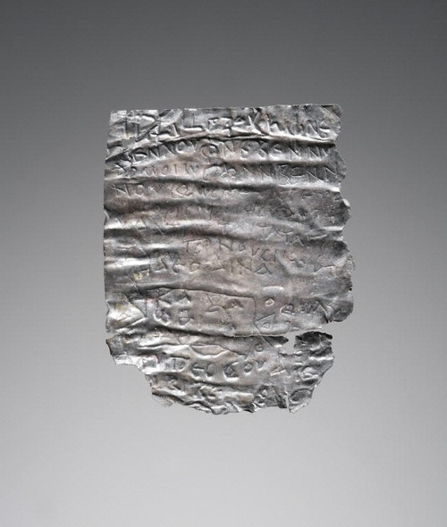 Silver lamella with greek magical inscription. It represents a type of amulet apparently in widespread use throughout the Roman empire. Such phylakteries served to protect the bearer from a specified disease or, more generally, from harm, evil, or demonic influences. The amulets engraved on slips of precious metal and worn to secure victory, improve business, or gain favor. Usually rolled up or folded and inserted into a tubular case hung around the neck.