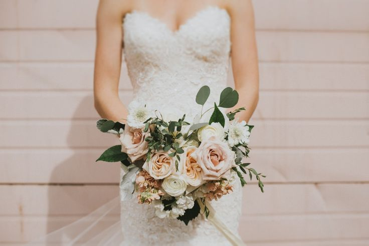 Courtney's perfectly pleasing pastel bouquet. Photo by Sara Rogers. Blush wedding dress with sweetheart neckline is Marianne by Maggie Sottero.