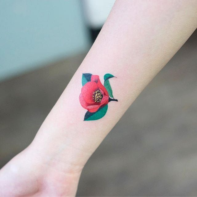 The vibrant colors found in Zihee's floral tattoos rival that of their real life counterparts.