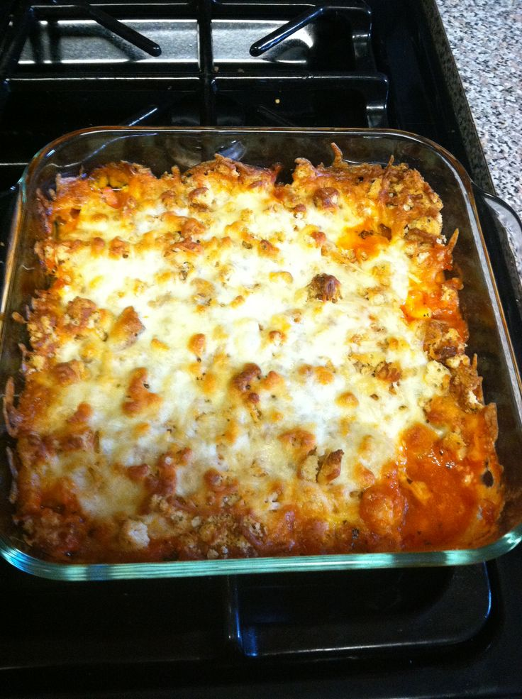 Chicken Parmesan Casserole ~ this is so easy and tastes amazing. The thing I love about it is you don't have to painstaking crumb and fry. This recipe is simple ..... Throw it all in the one dish and bake!