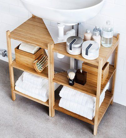 If you have a pedestal sink or wall-mount sink and no cabinets to speak of, there is still hope for you. These RÅGRUND shelves from IKEA are designed to fit around a pedestal sink or the pipe of a wall-mounted sink. -  10 Ways to Squeeze a Little Extra Storage Out of a Small Bathroom