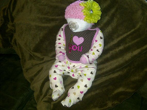 """You could use this diaper baby to play the """"Diaper a baby doll blindfolded"""" game at the shower. @babycenter"""