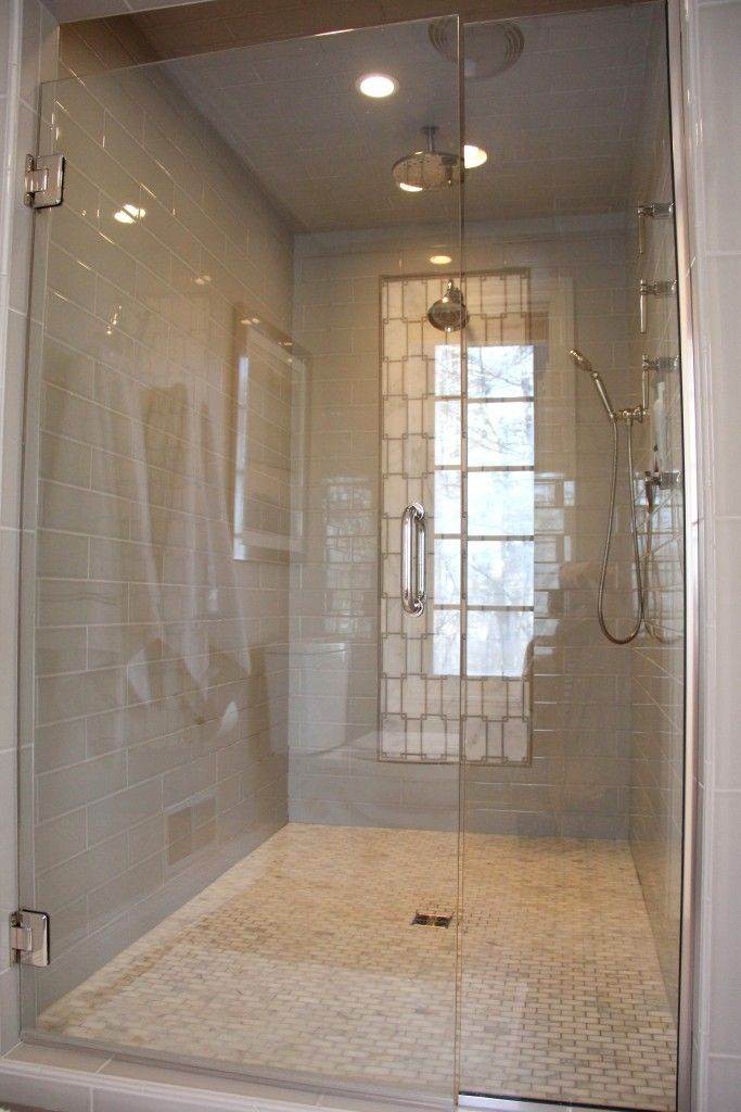 Shower Tile: H Line 4x16 Pumice, H Line Pencil Bullnose Pumice; Shower Floor Tile: Calcutta Gold 1x2 Polished Mosaic; Shower Mosaic Accent: Asian Carrara Mosaic 12x12 and 1/2x12 Polished Cinderella Gray; Shower Door: Clear Glass With Nickel Hardware