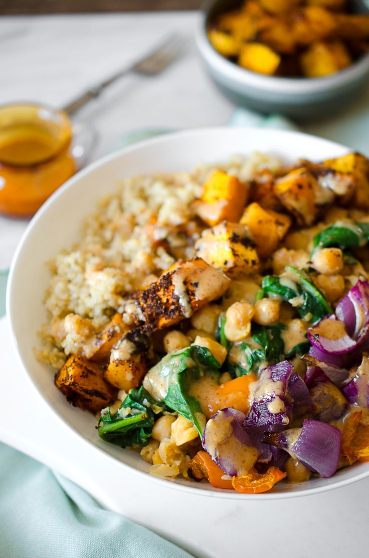 This Roasted Squash and Quinoa Buddha Bowl with Almond Citrus Sauce is filling and flavourful! What's the secret to a great buddha bowl? My thoughts.....
