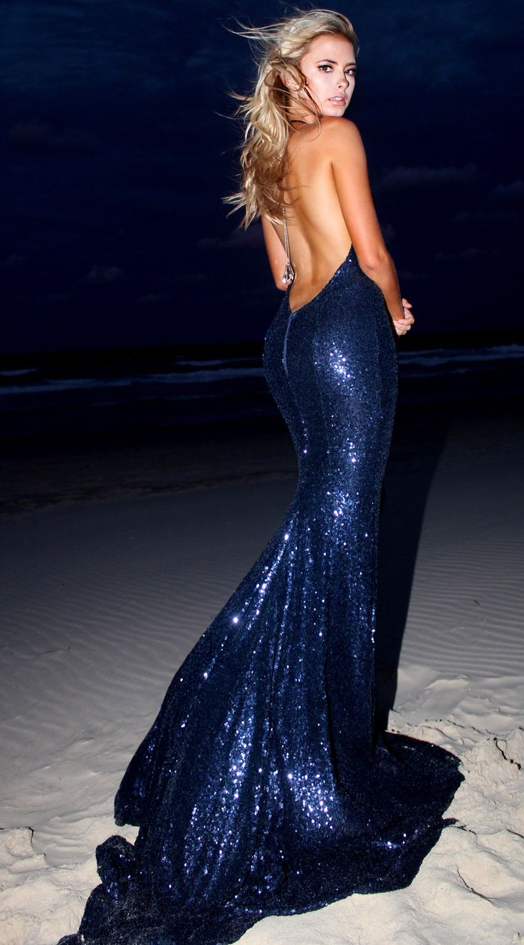 STUDIO MINC - Midnight mermaid marvels! We love how this stardust sequinned gown hugs the body in all of the right places. The fluidity of this fabric gives a very soft look and luminescence for evening wear.