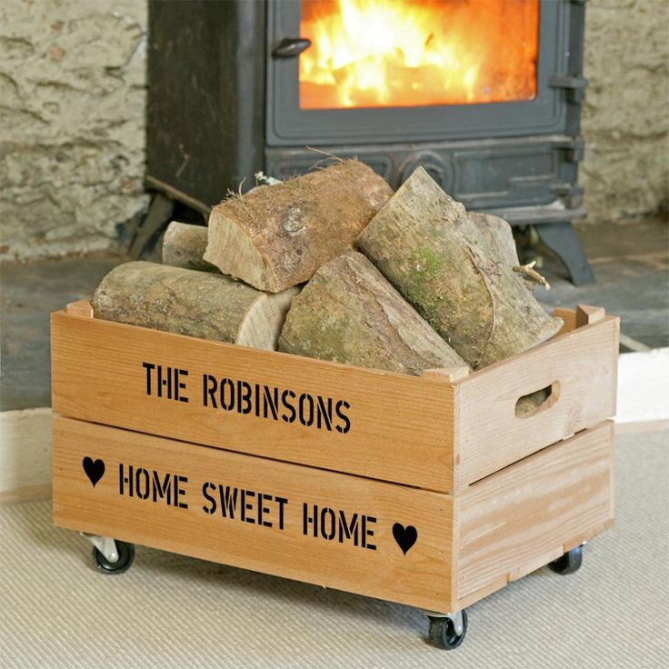 Large personalised wooden apple crate with added wheels is ideal for log storage