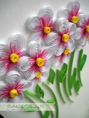 Quilled flowers, like the pink shading at the centers.