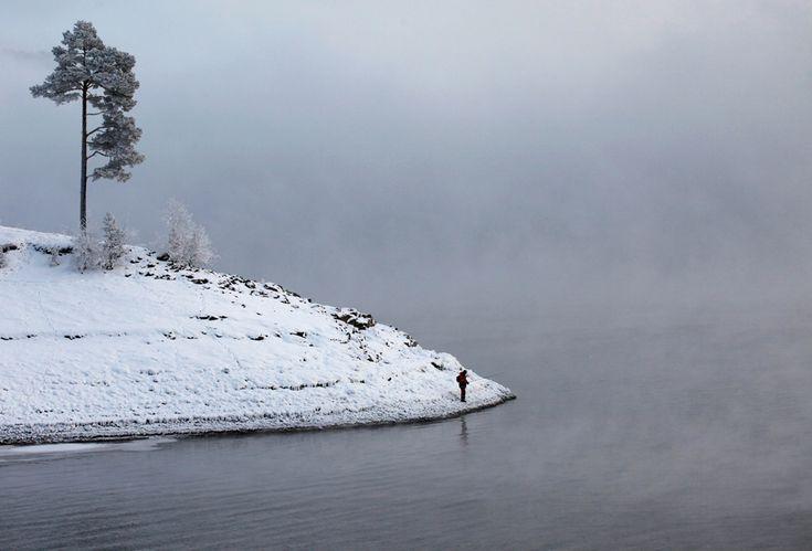 A fishman stands on the frozen bank of the Yenisei River near Krasnoyarsk. Yenisei River seasons - Photos - The Big Picture - Boston.com