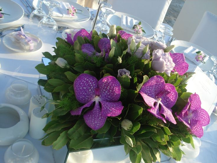 Table decoration with vanda orchids #tabledecor #orchidsvanda #amirandeshotel #weddingscrete #flowers #yuccaflowers #purple