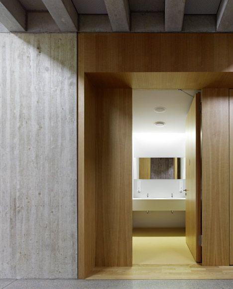 Wood and concrete inside the Mörike Gymnasium by Klumpp and Klumpp Architekten. Beautiful.