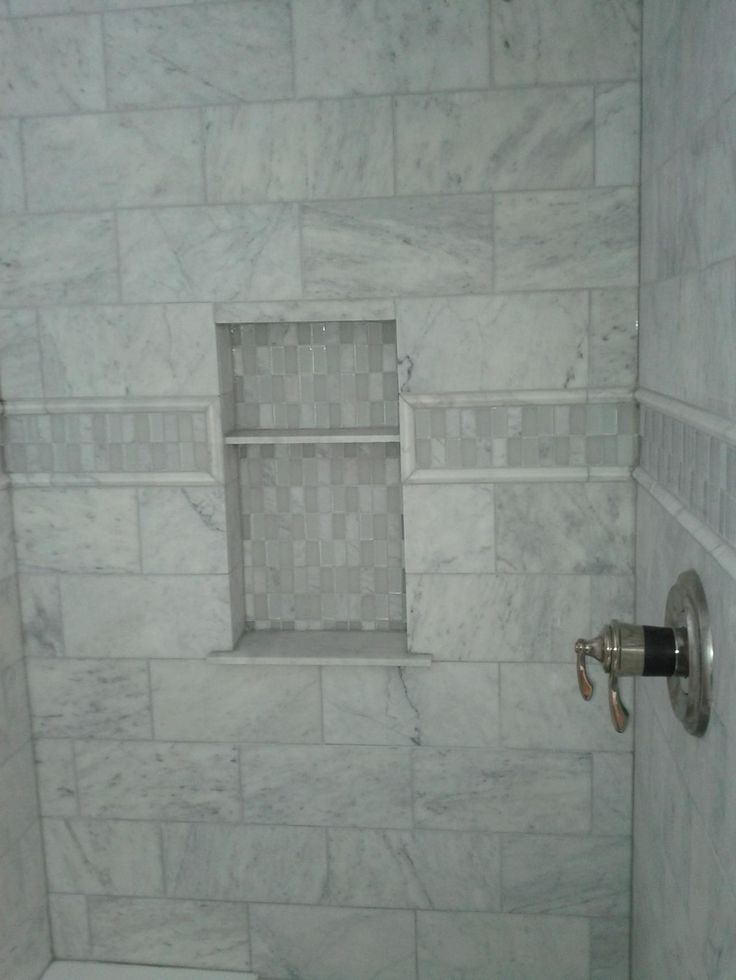This Picture Shows A Marble Tile Shower With An Accent