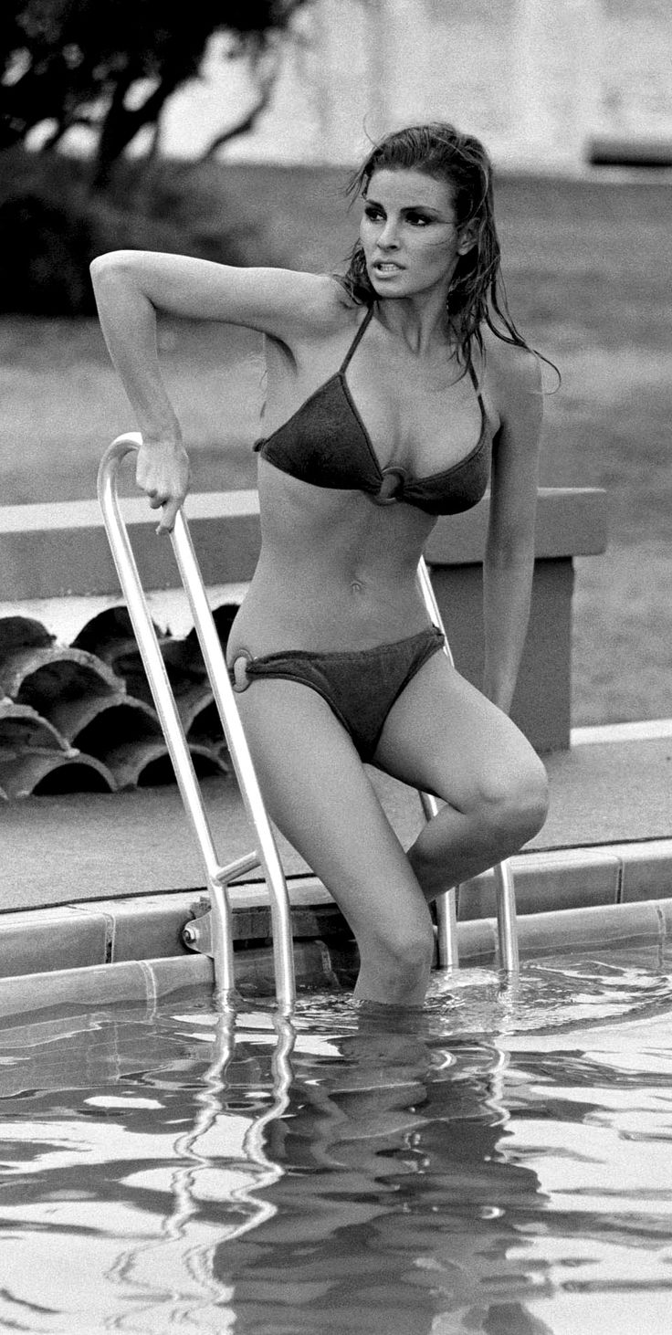 Raquel Welch enters a chilly pool during the filming of 'Lady in Cement', 1968. Photo by Terry O'Neill. °