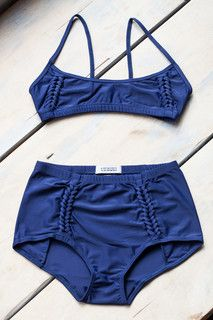 A Détacher Amanda Swimset in Navy. Braided trim details and a high waist are perfect for petite girls.
