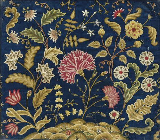 Embroidery in crewel wools on blue linen, circa 1740. This is from the Georgian era of English embroidery: https://en.wikipedia.org/wiki/English_embroidery#Georgian - which often featured Tree of Life patterns influenced by earlier crewelwork.