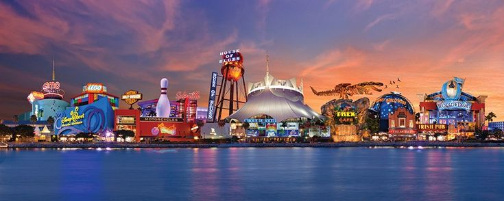 The night before we head home we hit Downtown Disney for shopping and dinner.  A view across a lake at sunset of Downtown Disney at Walt Disney World Resort