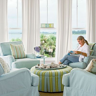 Pastel Living Room: This serene living room came together in a wash of pastels. To promote conversation, designer Jane Coslick opted for four chairs instead of the traditional sofa-centered seating arrangement; she repeated fabric from the dining room on the round ottoman to unify the look of the adjacent rooms.